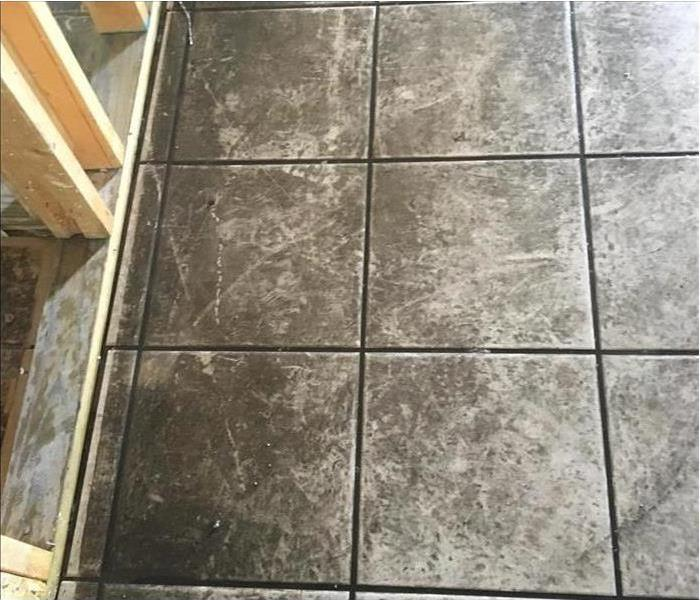 ceramic tile floor with black soot