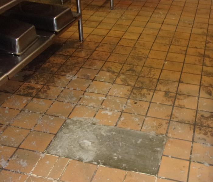 Cafeteria floor covered in sewage from backed up pipes